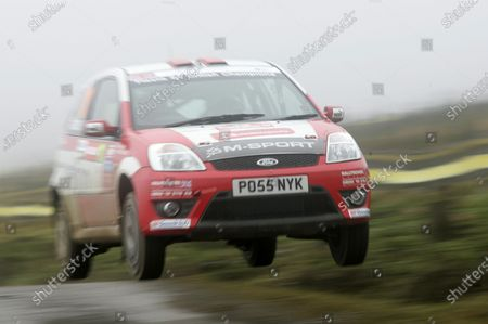 2006 World Rally Championship. Round 16. Wales Rally GB. 1st - 3rd December 2006. Chris Moore/Richard Edwards, Ford Fiesta ST. over a jump. Action. World Copyright: Alastair Staley/LAT Photographic.