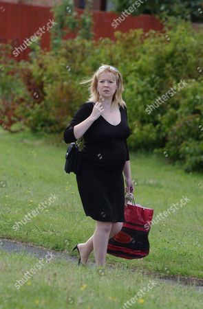 A Pregnant Rachel Lewis Returns From Shopping Walking In Her Home Town. One Of The Militay's Most Senior Communications Chiefs Has Been Suspended After Fathering A Love Child During A Torrid 15-month Affair. Colone Fred Chedham 43 Is Being Investigated Over Claims He Arranged Trysts At Top Hotels With Single Mother Rachel Lewis While On Official Army Business. The Army's A60 000-a-year Director Of Corporate Communicatins Is Also Accused Of Using His Military Postion To 'frighten Off' A Fellow Officer Who Had Become Friendly With His 27-year-old Mistress A Liberal Party Councillor In Bewdley Worcestershire. The Couple Split Up In December Last Year-after Mrs Lewis Fell Pregnant With His Second Child. She Is Due To Give Birth To A Daughter On August 27 The First Birthday Of Their Daughter Alice. Mrs Lewis Who Has Three Other Children From Two Previous Relationships Has Refused To Comment About The Case. But In A Statmtn Given To The Royal Military Police-leaked To The Daily Mail-she Reveals How The Colonel Whom She Called Freddy Was 'sex Obsessd' And Gave Her His Uniforms To Wear During Lovemaking. The Colonel Who Has Four Children With His Wife Alison Also Asked The Strawberry Blonde Councillor To Go Shopping Without Any Knickers On During A Business Weekend Away In Edinburgh. She Claimed That He Told Her The Though Would 'excite' Him While He Was At A Meeting. Mrs Lewis Said That Col Chedham 'implied' That The Hotels They Stayed In Would Be Paid For By The Army. Yesterday There Was No Sign Of The Colonel At His A300 000 Cottage In The Village Of Stoke St Gregory Somerset. His Wife Refused To Comment On The Allegations. Pix Brian Bould........... Story Dolan.
