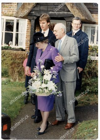 Stock Photo of Margaret Thatcher - 1990 Margaret Thatcher At Chequers Margaret And Denis Leaving Church For The Last Time And Presented With A Bouquet By Five Year Old Sarah Jane Smith....