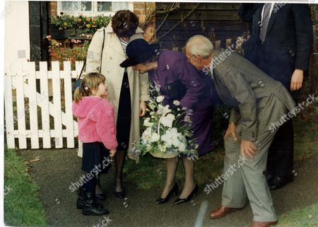 Editorial image of Baroness Thatcher Of Kesteven - 1990 Margaret Thatcher At Chequers Margaret And Denis Leaving Church For The Last Time And Presented With A Bouquet By Five Year Old Sarah Jane Smith