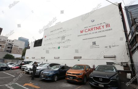 A preview of Paul McCartney's new musical production printed on a wall, in the Zona Rosa in Mexico City, Mexico, 09 December 2020. British musician Paul McCartney chose Mexico City, among some others, to show previews of his new musical production by posting the score of 'Pretty Boys' on a wall in the Mexican capital. A mural located in a parking lot in the central Zona Rosa of the Mexican capital announces that his new album 'McCartney III' the result of 'Rockdown' will arrive on 18 December.