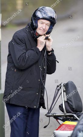 Jon Snow in a motorcycle helmet
