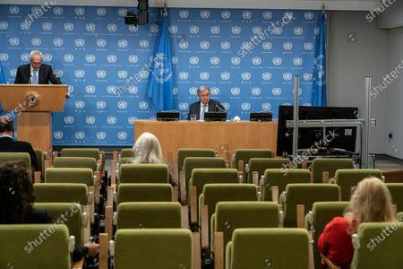 UN Secretary-General Antonio Guterres speaks during hybrid press stakeout with Chairperson of the AU Mr. Moussa Faki Mahamat at UN Headquarters. Chairperson of the African Union Moussa Faki Mahamat participating via teleconference from his office because of pandemic. Press briefings conducted at UN Headquarters are held in a hybrid manner: handful of journalists attend in person keeping social distance and others via video link. Spokesman for Secretary-General Stephane Dujarric De La Riviere leads press stakeout.