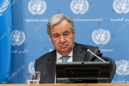 UN Secretary-General Antonio Guterres speaks during hybrid press stakeout with Chairperson of the AU Mr. Moussa Faki Mahamat at UN Headquarters. Chairperson of the African Union Moussa Faki Mahamat participating via teleconference from his office because of pandemic. Press briefings conducted at UN Headquarters are held in a hybrid manner: handful of journalists attend in person keeping social distance and others via video link.