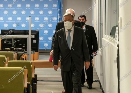 UN Secretary-General Antonio Guterres leaves after hybrid press stakeout with Chairperson of the AU Mr. Moussa Faki Mahamat at UN Headquarters. Chairperson of the African Union Moussa Faki Mahamat participating via teleconference from his office because of pandemic. Press briefings conducted at UN Headquarters are held in a hybrid manner: handful of journalists attend in person keeping social distance and others via video link.