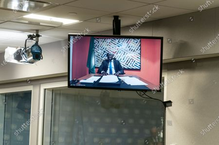 Chairperson of the AU Mr. Moussa Faki Mahamat (seen on the screen) speaks via teleconference link during hybrid press stakeout with UN Secretary-General Antonio Guterres at UN Headquarters. Chairperson of the African Union Moussa Faki Mahamat participating via teleconference from his office because of pandemic. Press briefings conducted at UN Headquarters are held in a hybrid manner: handful of journalists attend in person keeping social distance and others via video link.