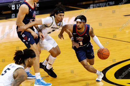 Liberty's Chris Parker, right, dribbles around Missouri's Drew Buggs, middle, during the first half of an NCAA college basketball game, in Columbia, Mo