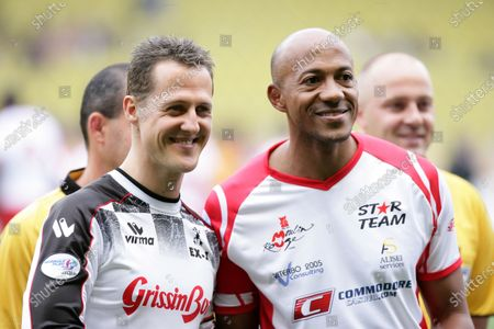 2006 Monaco Grand Prix - Tuesday Preview Monte Carlo, Monaco. 23rd - 28th May. Charity Football Match - Micahel Schumacher with Frankie Fredericks. Portrait. World Copyright: Michael Cooper/LAT Photographic