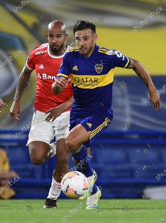 Boca's Eduardo Salvio (R) vies for the ball with Patrick Bezerra (L) of Internacional during the Copa Libertadores round of 16 second leg match between Club Atletico Boca Juniors of Argentina and Sport Club Internacional of Brazil, in Buenos Aires, Argentina, 09 December 2020.
