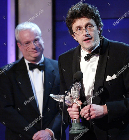 Stock Image of Pawel Pawlikowski Received His Award For Best Screenplay (for My Summer Of Love) From Former Labour Culture Minister Chris Smith (now Baron Smith Of Finsbury)at The 2005 Evening Standard British Film Awards.