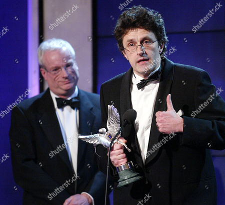 Editorial image of Pawel Pawlikowski Received His Award For Best Screenplay (for My Summer Of Love) From Former Labour Culture Minister Chris Smith (now Baron Smith Of Finsbury) At The 2005 Evening Standard British Film Awards.