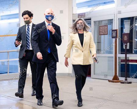 U.S. Senator Rick Scott (R-FL) and U.S. Senator Joni Ernst (R-IA) are seen at the Senate Subway.