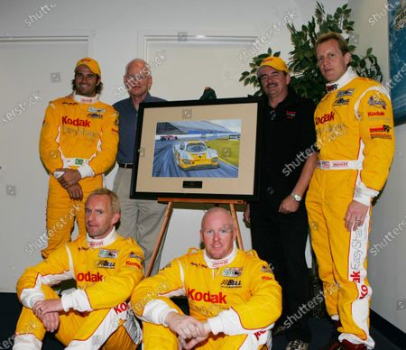 5-6 February, 2005, Rolex 24 @ Daytona International Speedway, Daytona, Florida, USA Christian Fittipaldi, Forest Barber, Jim Bell, Terry Borcheller and Ralf Kelleners surround a new painting by the artist named Warrick depicting this team's win at the '04 24. C: 2005, Denis L. Tanney, USA LAT Photographic