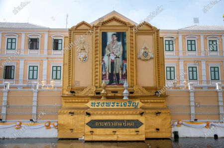 View of a portrait of King Maha Vajiralongkorn in front of the Ministry of Defence of Thailand.