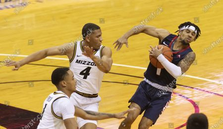 Liberty's Chris Parker, right, and Missouri's Javon Pickett, left, battle for a rebound during the first half of an NCAA college basketball game, in Columbia, Mo