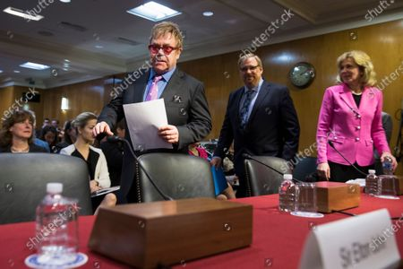 Musician Sir Elton John, followed by Rev. Rick Warren and Ambassador at Large and Coordinator of the U.S. Government Activities to Combat HIV/AIDS, Dr. Deborah L. Birx, arrives on Capitol Hill in Washington. Birx was brought into President Donald Trump's orbit to help fight the coronavirus, she had a sterling reputation as a globally recognized AIDS researcher and a rare Obama administration holdover. Less than 10 months later, her reputation is frayed and her future in President-elect Joe Biden's administration uncertain
