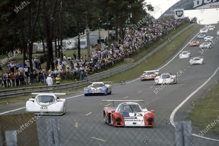1985 Le Mans 24 Hours Le Mans, France. 15th - 16th June. Yves Courage/Alain de Cadenet/Jean-Francois Yvon (Cougar C12-Porsche) leads Brian Redman/Hurley Haywood/Jim Adams (Jaguar XJR-5). World Copyright: Murenbeeld/LAT Photographic
