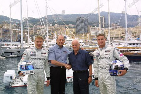 Monaco Grand Prix. Monte Carlo, Monaco. 24-27 May 2001. (L-R) Mika Hakkinen (McLaren Mercedes), TAG McLaren Group Chairman and C.E O. Ron Dennis, Hugo Boss C.E O. Werner Baldessarini and David Coulthard (McLaren Mercedes) mark the extension of Boss' sponsorship agreement with the team, announced this morning. Photo: Steven Tee. Copyright Free for Editiorial Use Only.