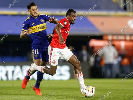 Eduardo Salvio of Boca Juniors and Edenilson of Internacional