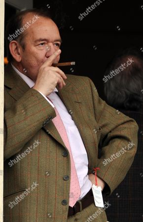 Mel Smith Enjoys A Cigar While Watching The Racing At The Cheltenham Festival 11.03.08 Cheltenham Festival Day Two.