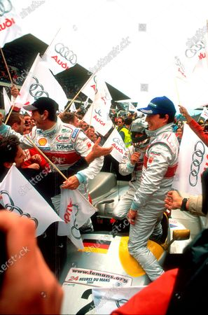 Stock Image of 2001 Le Mans 24 Hours Le Mans, France. 12th June 2001. The 2nd placed Joest Audi R8 of Laurent Aiello, Rinaldo Capello and Christian Pescatori celebrate. World Copyright: Simon Fox/LAT Photographic
