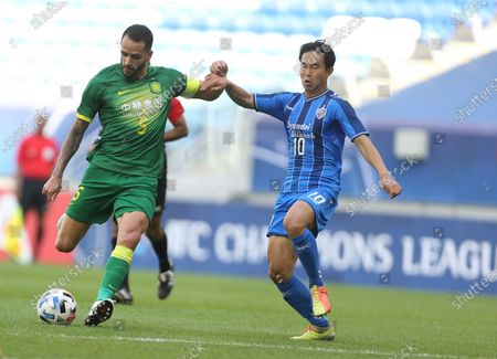 Beijing's Renato Augusto, left, and Yun Bit-Garam fight for the ball during a quarter final AFC Champions League match in Al Wakrah, Qatar