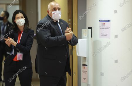 Bulgaria's Prime Minister Boyko Borissov uses hand sanitizer as he arrives for a round table meeting at an EU summit at the European Council building in Brussels, . European Union leaders meet for a year-end summit that will address anything from climate, sanctions against Turkey to budget and virus recovery plans. Brexit will be discussed on the sidelines