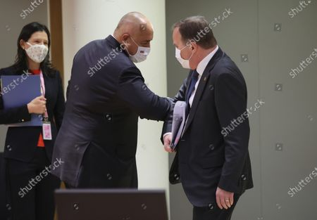 Bulgaria's Prime Minister Boyko Borissov, center, greets Sweden's Prime Minister Stefan Lofven, right, with an elbow bump during a round table meeting at an EU summit at the European Council building in Brussels, . European Union leaders meet for a year-end summit that will address anything from climate, sanctions against Turkey to budget and virus recovery plans. Brexit will be discussed on the sidelines