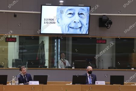 Stock Photo of French President Emmanuel Macron, left, and Slovenia's Prime Minister Janez Jansa watch a short clip to remember late French President Valery Giscard d'Estaing during a round table meeting at an EU summit in Brussels, . European Union leaders meet for a year-end summit that will address anything from climate, sanctions against Turkey to budget and virus recovery plans. Brexit will be discussed on the sidelines