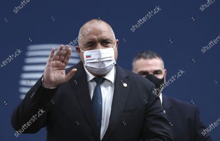 Bulgaria's Prime Minister Boyko Borissov waves as he arrives for an EU summit at the European Council building in Brussels, . European Union leaders meet for a year-end summit that will address anything from climate, sanctions against Turkey to budget and virus recovery plans. Brexit will be discussed on the sidelines