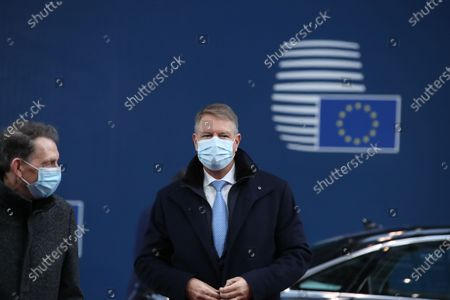 Romania's President Klaus Werner Johannis wearing a face mask arrives for the start of a two days face-to-face EU summit, in Brussels, Belgium, 10 December 2020. EU Leader will mainly focus on response to the COVID-19, Multi annual framework (MFF) agreement and new EU emissions reduction target for 2030.