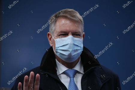 Stock Photo of Romania's President Klaus Werner Johannis wearing a face mask arrives for the start of a two days face-to-face EU summit, in Brussels, Belgium, 10 December 2020. EU Leader will mainly focus on response to the COVID-19, Multi annual framework (MFF) agreement and new EU emissions reduction target for 2030.