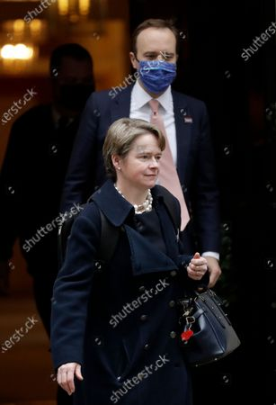 """Dido Harding, the head of the National Health Service coronavirus Test and Trace programme, leaves ahead of British Health Secretary Matt Hancock, leaving 10 Downing Street, in London, . Britain started vaccinating some of its most vulnerable people and key workers against the coronavirus earlier this week in what was described as a """"turning point"""" to stop the pandemic"""