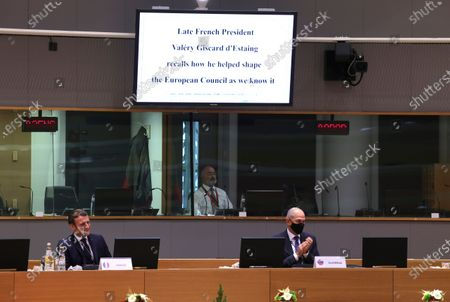 Stock Image of French President Emmanuel Macron (L) and Slovenia's Prime Minister Janez Jansa listen to a short statement on the passing away of former French President Valery Giscard d'Estaing at the start of a two days face-to-face EU summit , in Brussels, Belgium, 10 December 2020.  EU Leader will mainly focus on response to the COVID-19, Multi annual framework (MFF) agreement , new EU emissions reduction target for 2030.