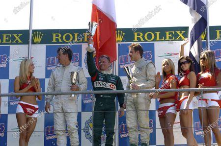 2005 Le Mans LegendsLe Mans, France. 17th - 18th JuneJohnny Herbert (Jaguar D - Type) celebrates victory on the podium with Willie Green (Jaguar D - Type) and Benjamin Eastick (Jaguar D - Type). World Copyright: Jeff Bloxham Ref: Digital image only.