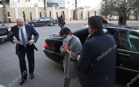 Stock Photo of Spanish Foreign Minister Arancha Gonzalez Laya (C ) and Palestinian Foreign Minister Riyad Al-Maliki (L) arrive for a meeting wirh Palestinian Prime Minister Mohammad Ashtiyeh  in the West Bank city of Ramallah, 10 December 2020.