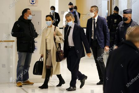 Former French president Nicolas Sarkozy (C) and his lawyer Jacqueline Laffont (L) arrive at the court for his trial on corruption charges in the so-called 'wiretapping affair' in Paris, France, 10 December 2020. In 2013, Nicolas Sarkozy was using a false name, Paul Bismuth, to make phone calls to his lawyer, Thierry Herzog, about the decision that the Court of Cassation was about to take regarding the seizure of presidential diaries in a separate case. The trial is due to run from 23 November to 10 December 2020.