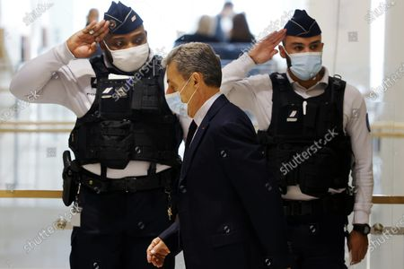 Former French president Nicolas Sarkozy (C) arrives at the court for his trial on corruption charges in the so-called 'wiretapping affair' in Paris, France, 10 December 2020. In 2013, Nicolas Sarkozy was using a false name, Paul Bismuth, to make phone calls to his lawyer, Thierry Herzog, about the decision that the Court of Cassation was about to take regarding the seizure of presidential diaries in a separate case. The trial is due to run from 23 November to 10 December 2020.