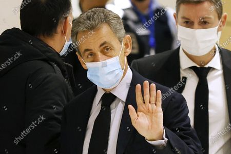 Stock Image of Former French president Nicolas Sarkozy (C) arrives at the court for his trial on corruption charges in the so-called 'wiretapping affair' in Paris, France, 10 December 2020. In 2013, Nicolas Sarkozy was using a false name, Paul Bismuth, to make phone calls to his lawyer, Thierry Herzog, about the decision that the Court of Cassation was about to take regarding the seizure of presidential diaries in a separate case. The trial is due to run from 23 November to 10 December 2020.