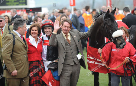 The Ladbrokes World Hurdle Race, Big Buck's and Ruby Walsh with (L) trainer Paul Nicholls and (R) owner Andy Stewart after returning to the winner's enclosure after winning