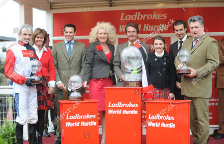 The Ladbrokes World Hurdle Race, Big Buck's connections after receiving their trophies inc jockey Ruby Walsh, owner Andy Stewart and trainer Paul Nicholls