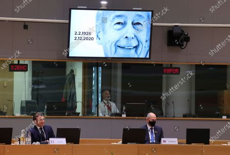 French President Emmanuel Macron (L) and Slovenia's Prime Minister Janez Jansa watch a short clip to remember late French President Valery Giscard d'Estaing at the start of a two days face-to-face EU summit in Brussels, Belgium, 10 December 2020. The EU leader will mainly focus on response to the COVID-19 pandemic, the multi annual framework (MFF) agreement and a new EU emissions reduction target for 2030.
