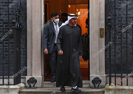 Crown Prince of the Emirate of Abu Dhabi, Sheikh Mohammed bin Zayed Al Nahyan (R) leaves 10 Downing Street after a meeting with Britain's Prime Minister Johnson in London, Britain, 10 December 2020.
