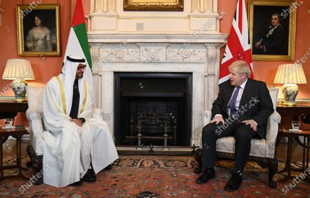 British Prime Minister Boris Johnson (R) meets Crown Prince of Abu Dhabi Sheikh Mohammed bin Zayed Al Nahyan (L) at 10 Downing Street in London, Britain, 10 December 2020.