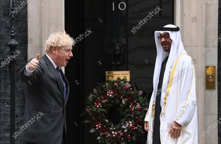 Britain's Prime Minister Boris Johnson (L) welcomes Crown Prince of the Emirate of Abu Dhabi, Sheikh Mohammed bin Zayed Al Nahyan (R) to his official residence at 10 Downing Street in London, Britain, 10 December 2020.