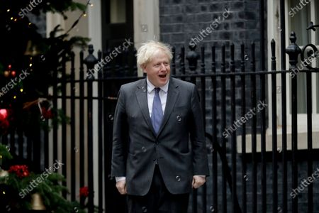 """British Prime Minister Boris Johnson greets Abu Dhabi Crown Prince Sheikh Mohammed bin Zayed Al Nahyan as he arrives for their meeting outside 10 Downing Street, in London, . Britain's foreign minister said Thursday that negotiations on a trade deal with the European Union will reach a """"moment of finality"""" this weekend, with both sides assessing chances of an agreement as slim"""
