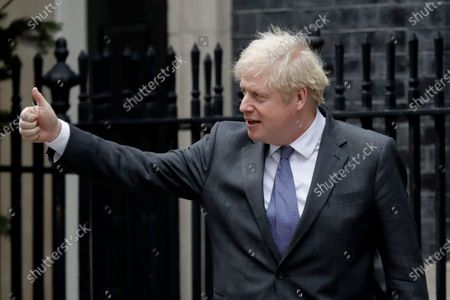 """Stock Image of British Prime Minister Boris Johnson greets Abu Dhabi Crown Prince Sheikh Mohammed bin Zayed Al Nahyan as he arrives for their meeting outside 10 Downing Street, in London, . Britain's foreign minister said Thursday that negotiations on a trade deal with the European Union will reach a """"moment of finality"""" this weekend, with both sides assessing chances of an agreement as slim"""