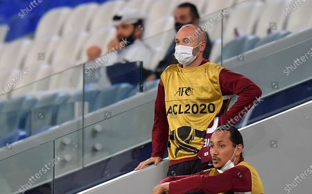 Andres Iniesta (top) of Vissel Kobe watches from the stands during the AFC Champions League quarter final match between Vissel Kobe and Suwon Samsung Bluewings at the Al Janoub Stadium in Al Wakrah, Qatar, 10 December 2020.
