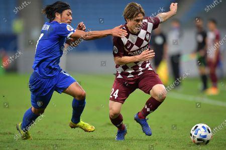 Gotoku Sakai (R) of Vissel in action against Ko Seung-Beom of Suwon during the AFC Champions League quarter final match between Vissel Kobe and Suwon Samsung Bluewings at the Al Janoub Stadium in Al Wakrah, Qatar, 10 December 2020.