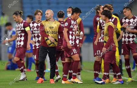 Andres Iniesta (3-L) of Vissel Kobe talks to teammates as the AFC Champions League quarter final match between Vissel Kobe and Suwon Samsung Bluewings goes into extra time at the Al Janoub Stadium in Al Wakrah, Qatar, 10 December 2020.